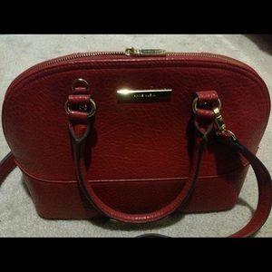 Red Anne Klein handbag....